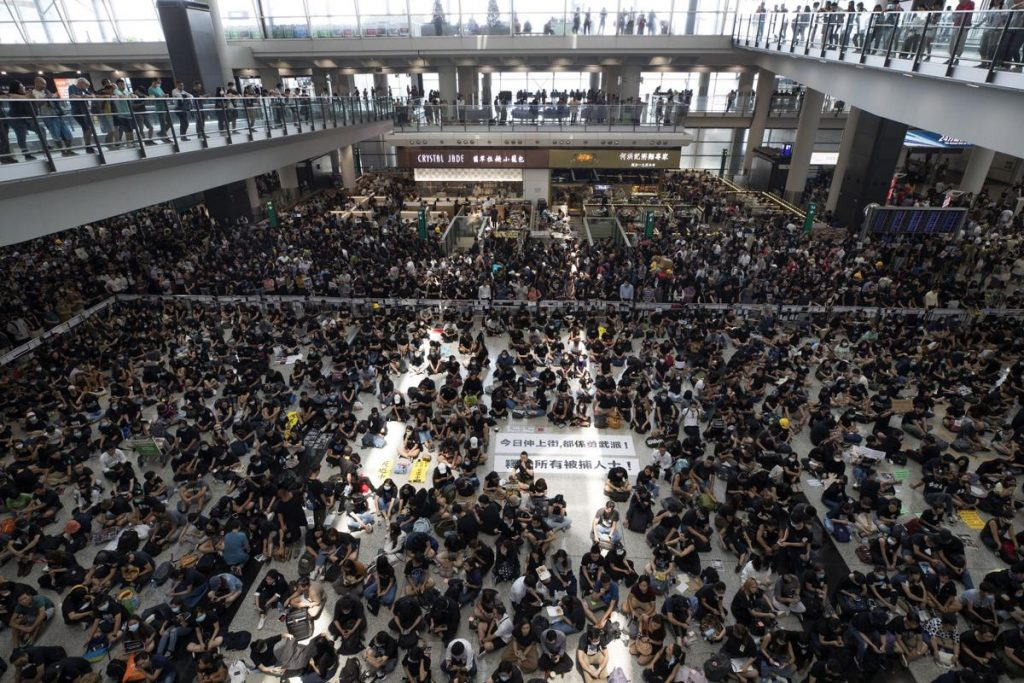 Flight disruptions continue as Hong Kong airport protests enter fifth day