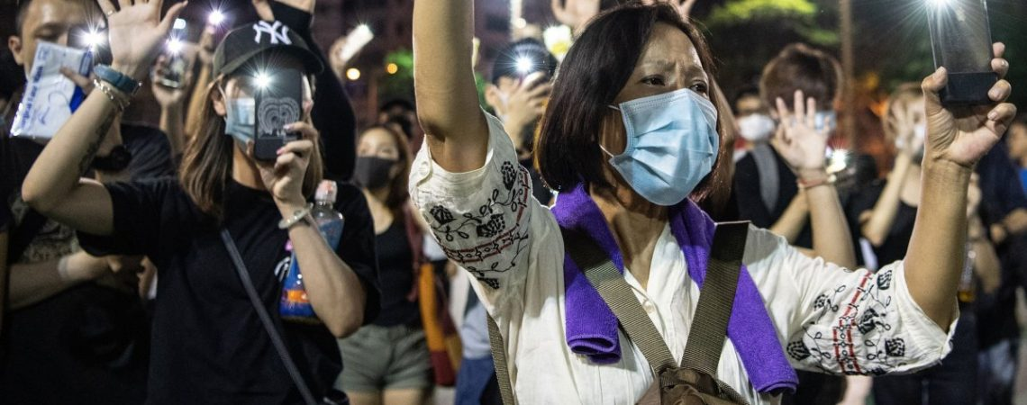 Protesters appear to be hit by taxi and man beaten bloody in another violent turn for Hong Kong