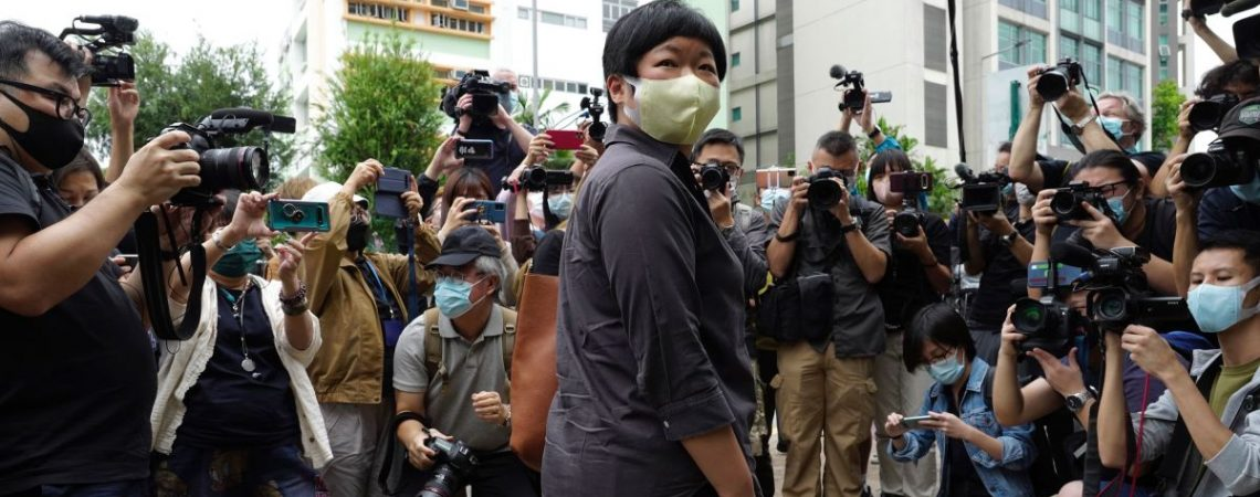 Hong Kong journalist appears in court as crackdown fears grow